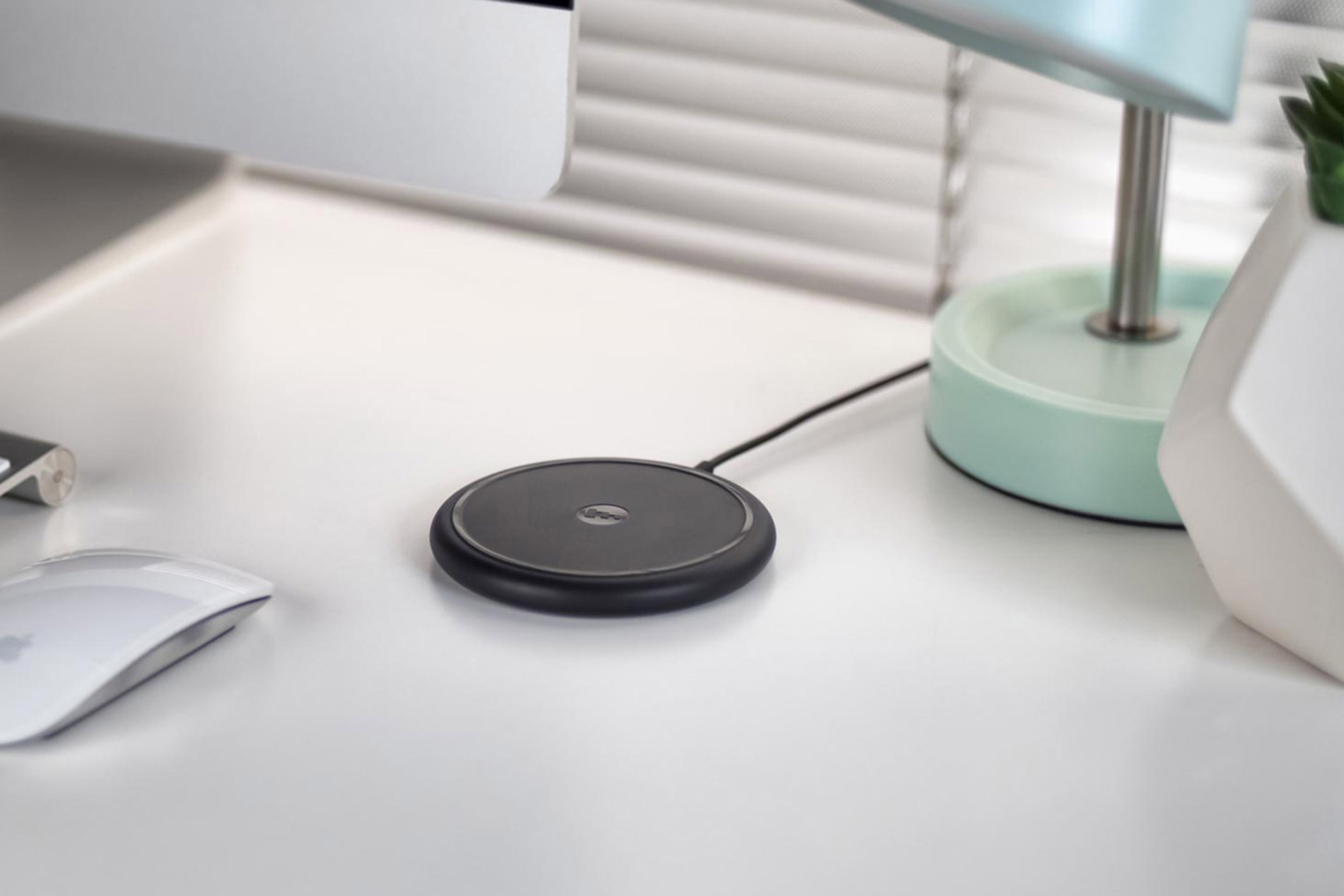 mophie wireless charging base on desk for iPhone