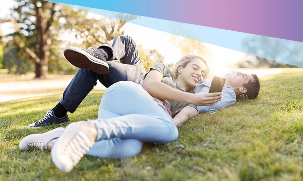 Telstra Unlimited Data two people on phones on grass