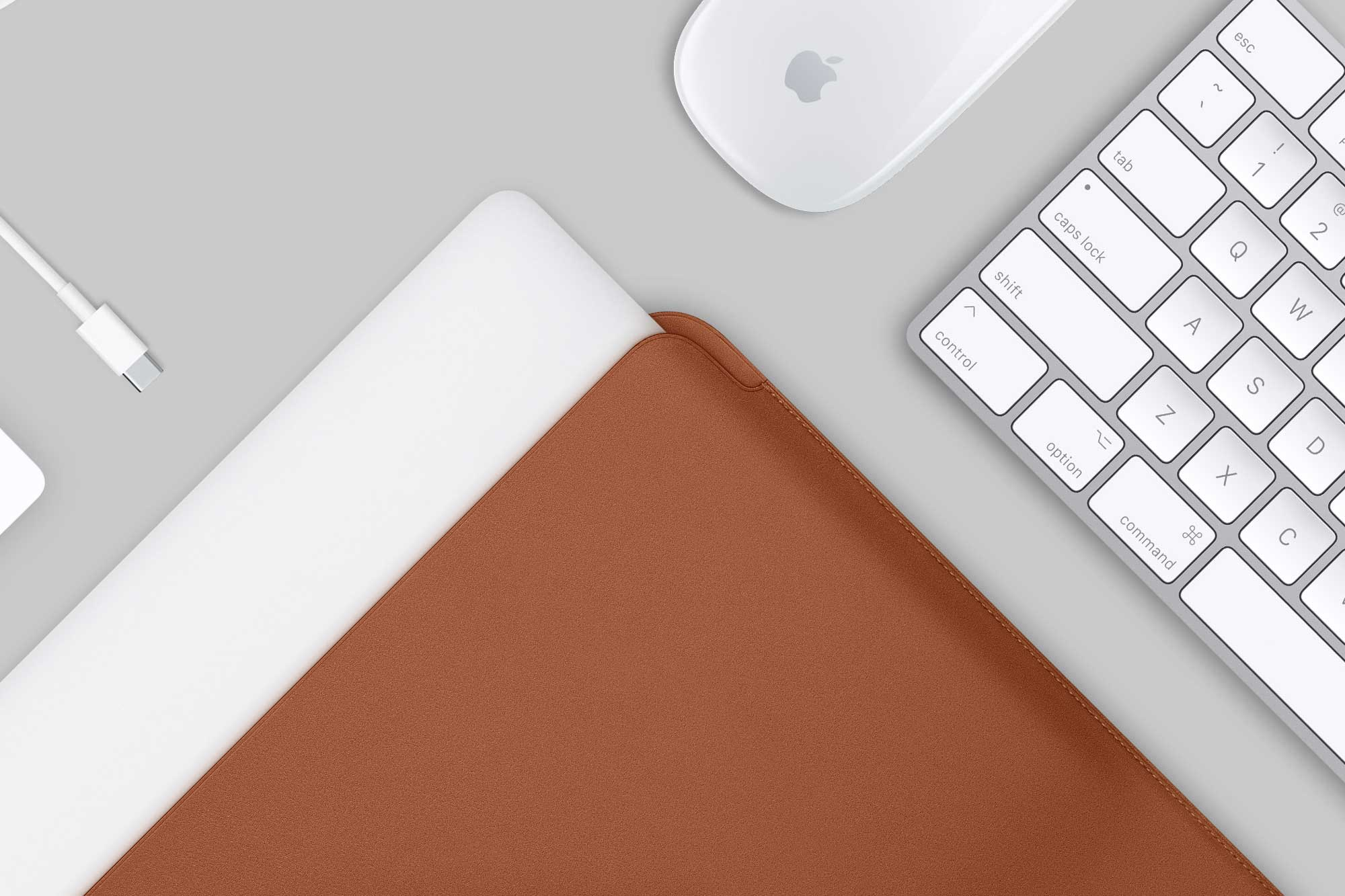 New MacBook Pro with Tan Leather Sleeve and accessories