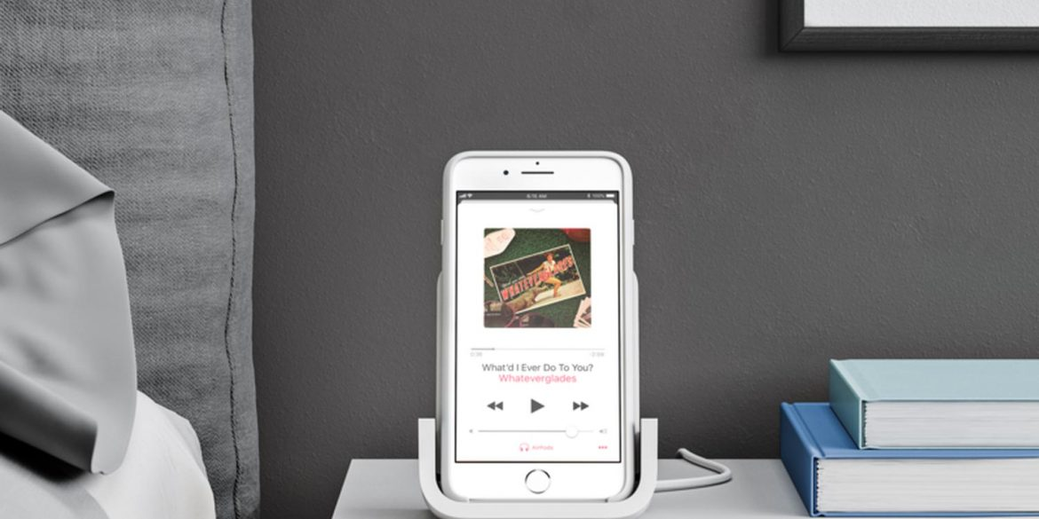 Logitech POWERED Wireless Charging Stand on bedside table with iPhone