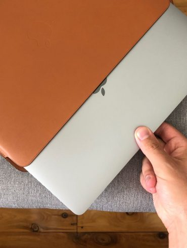 Leather Sleeve for 13?inch MacBook Pro Saddle Brown pulling MacBook Pro