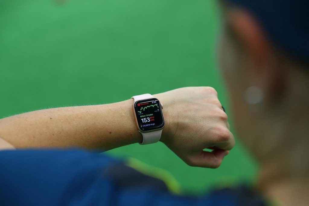 Australian Cricket Team Player Looking At Apple Watch with Heart Rate