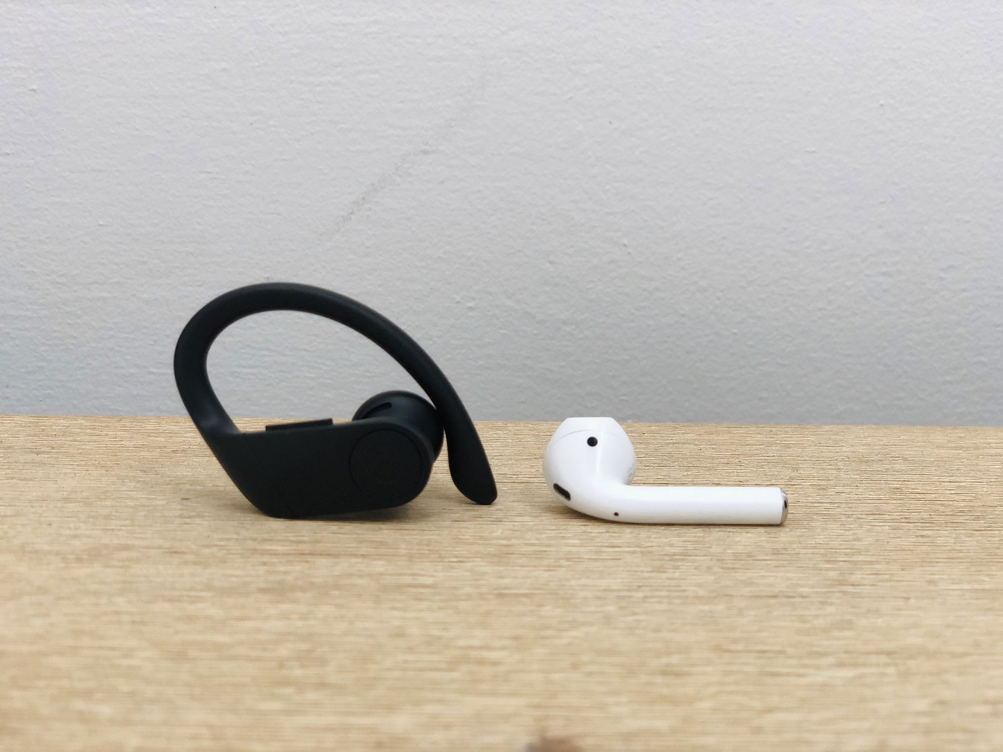 Apple AirPods and Powerbeats Pro side by side