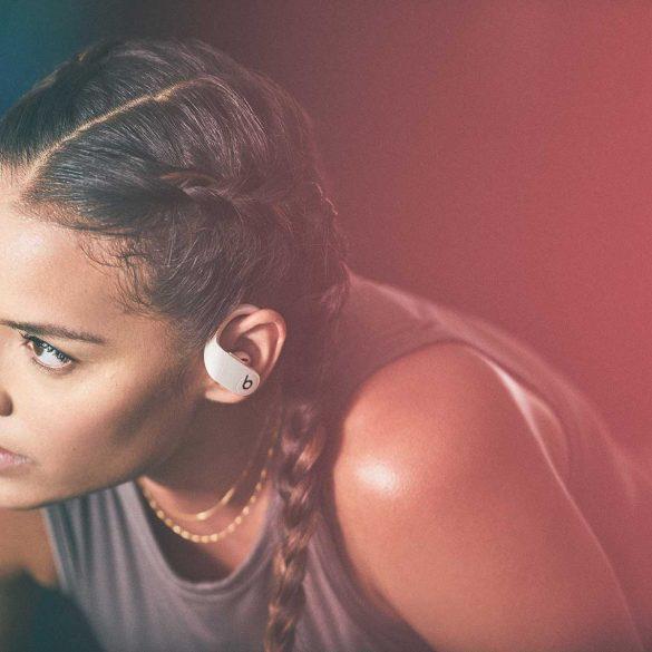 Girl wearing Beats Powerbeats Pro in Ivory Colour