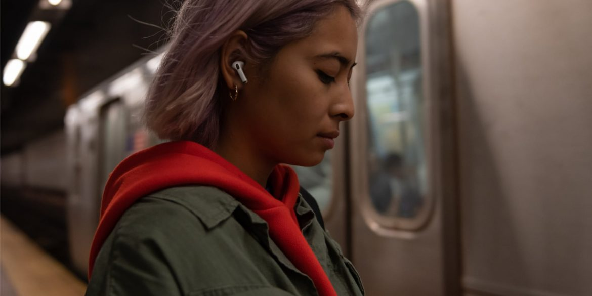 Girl Wearing AirPods Pro on Train
