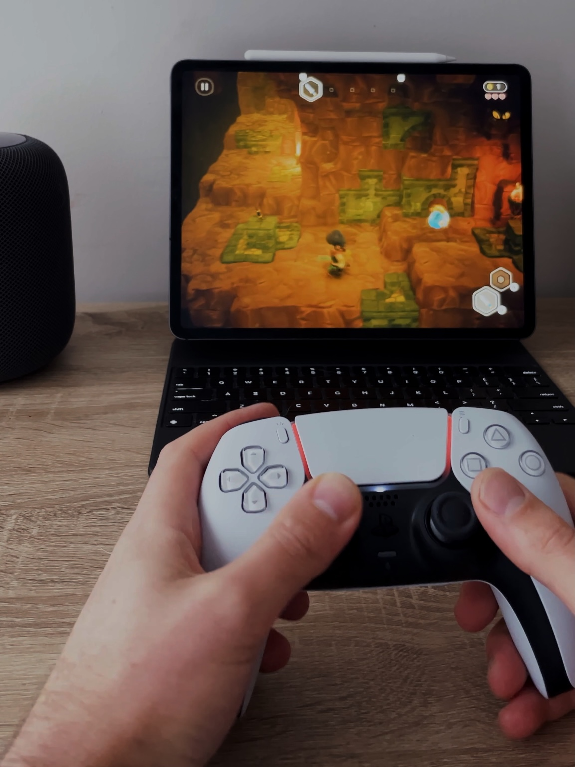 Playstation 5 Controller playing game on iPad Pro